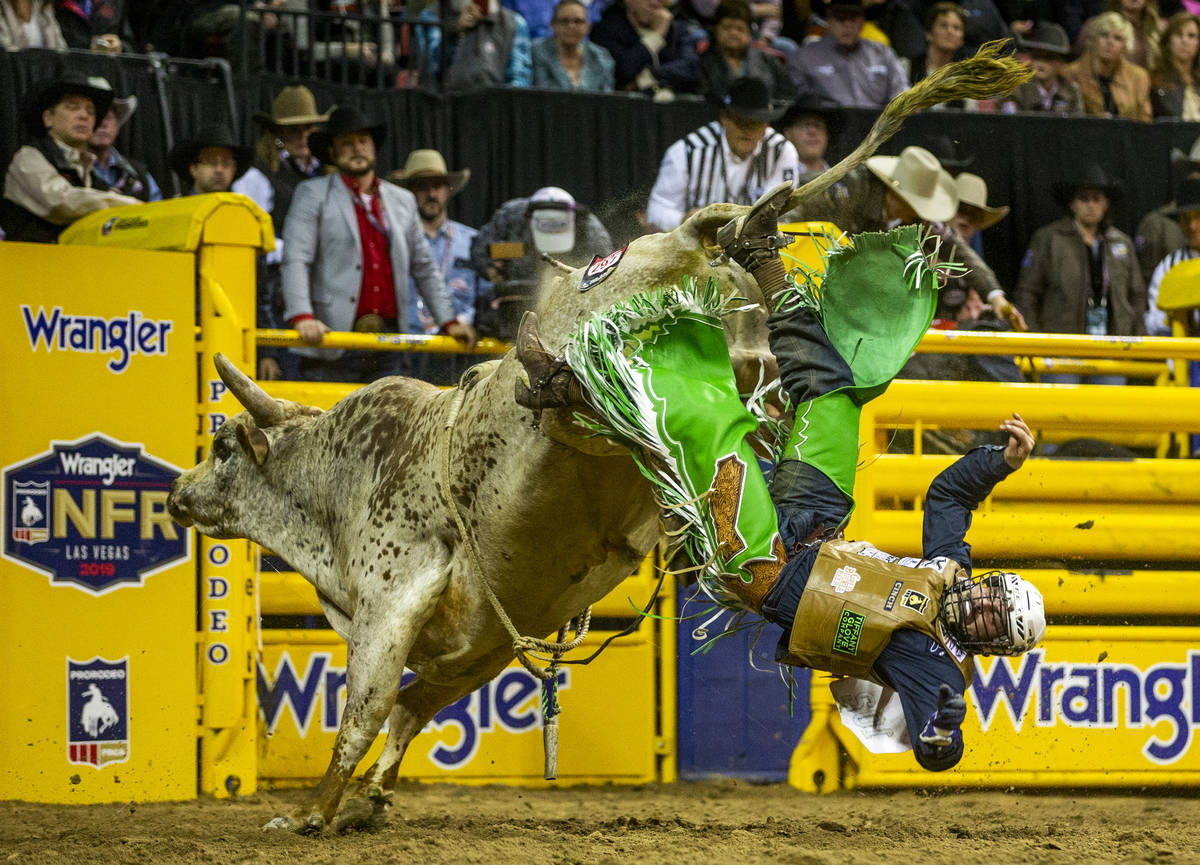 Jordan Spears of Redding, Calif., is tossed off the back in Bull Riding at the tenth go round o ...