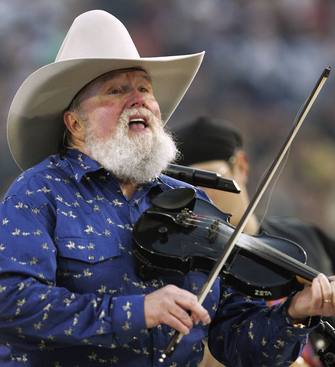 Charlie Daniels performs during pre-game festivities before Super Bowl XXXIX between the New En ...