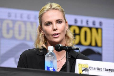 "Charlize Theron speaks at the ""Women Who Kick Ass"" panel on day three of Comic-Con In ..."
