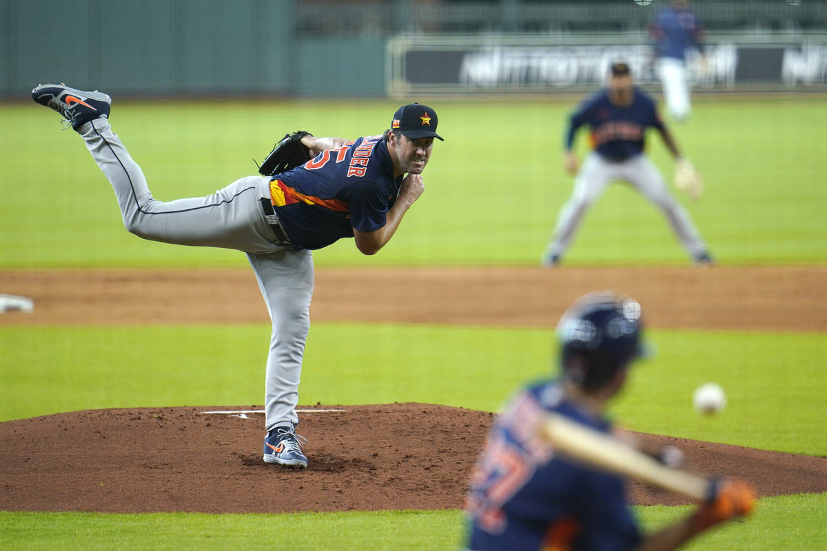 Houston Astros starting pitcher Justin Verlander throws during a simulated baseball game Thursd ...