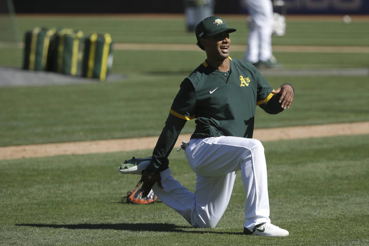 Oakland Athletics' Khris Davis stretches during a baseball practice in Oakland, Calif., Saturda ...
