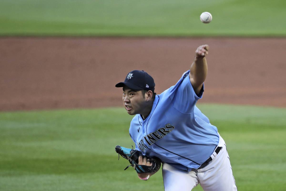 "Seattle Mariners pitcher Yusei Kikuchi throws Monday, July 20, 2020, during a ""summer camp ..."