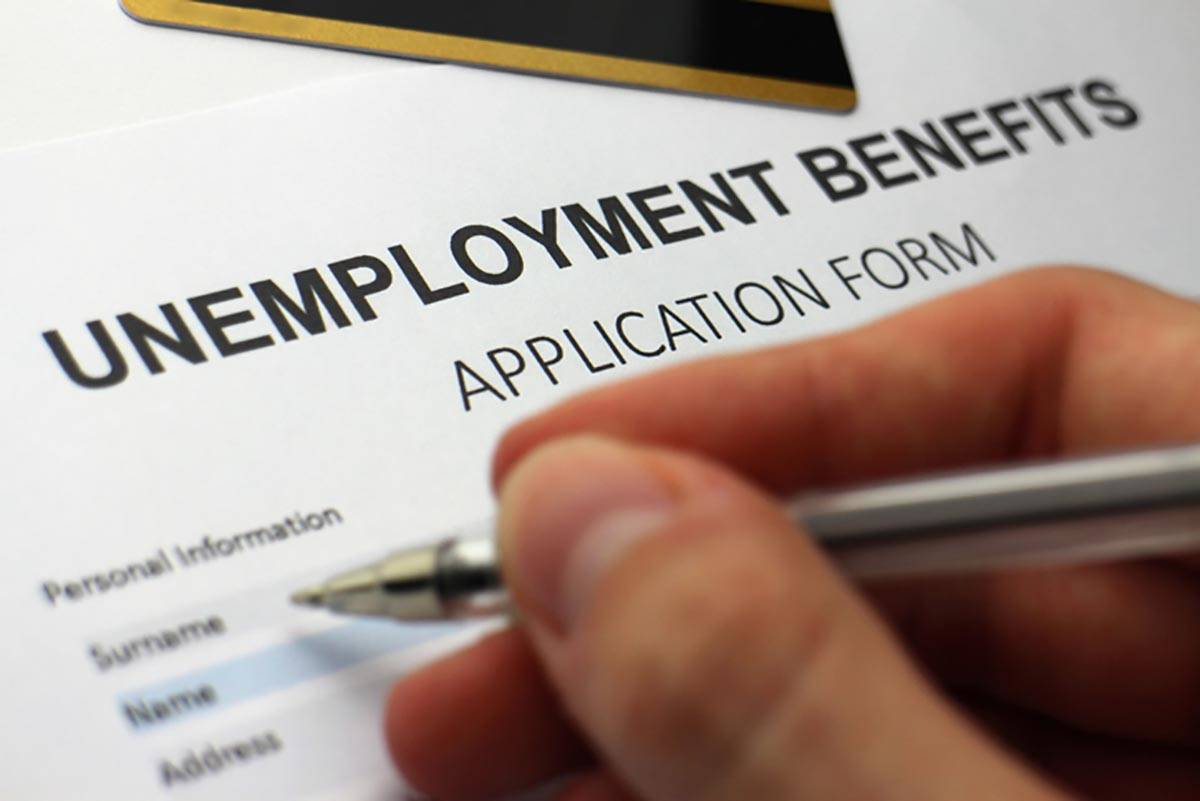 Someone completing an unemployment benefits form.In March, the $2 trillion Coronavirus Aid, Rel ...