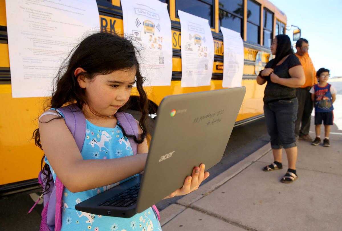 Paula Santana, 7, works on homework at the Clark County School District Wi-Fi school bus Aloha ...