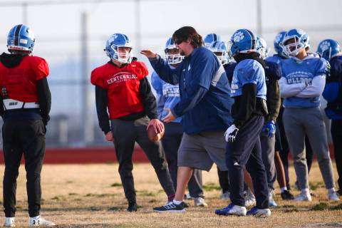 Centennial football coach Dustin Forshee, right, motions in front of quarterback Colton Tenney, ...