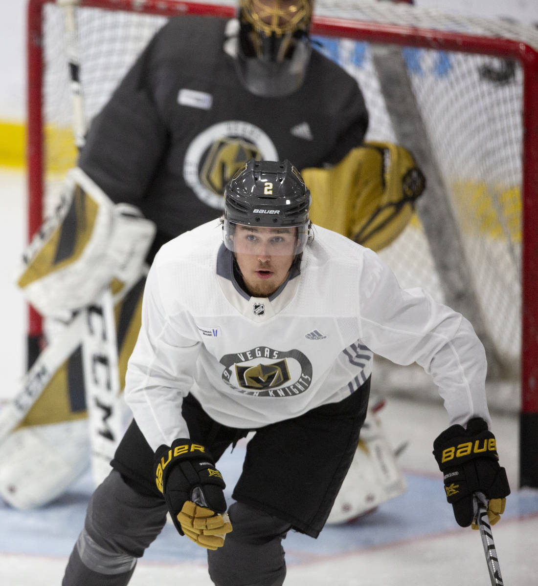 Golden Knights' defenseman Zach Whitecloud (2) skates toward the action during practice at City ...