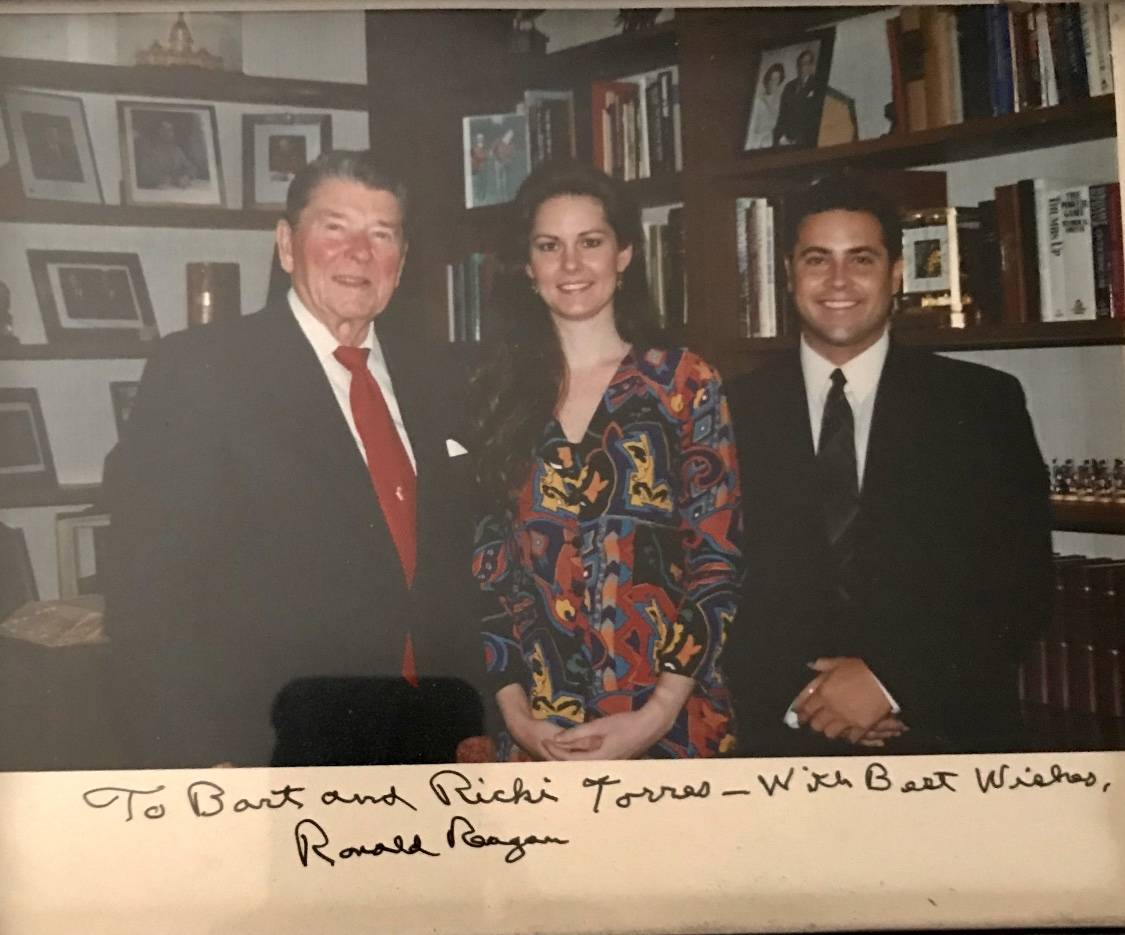 Ricki and Bart Torres are shown with President Reagan in November 1993. Torres was Reagan's vid ...