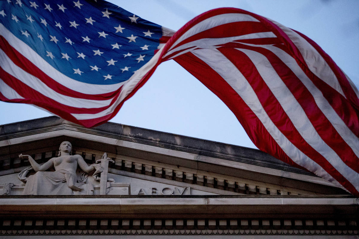 In a March 22, 2019 file photo, an American flag flies outside the Department of Justice in Was ...
