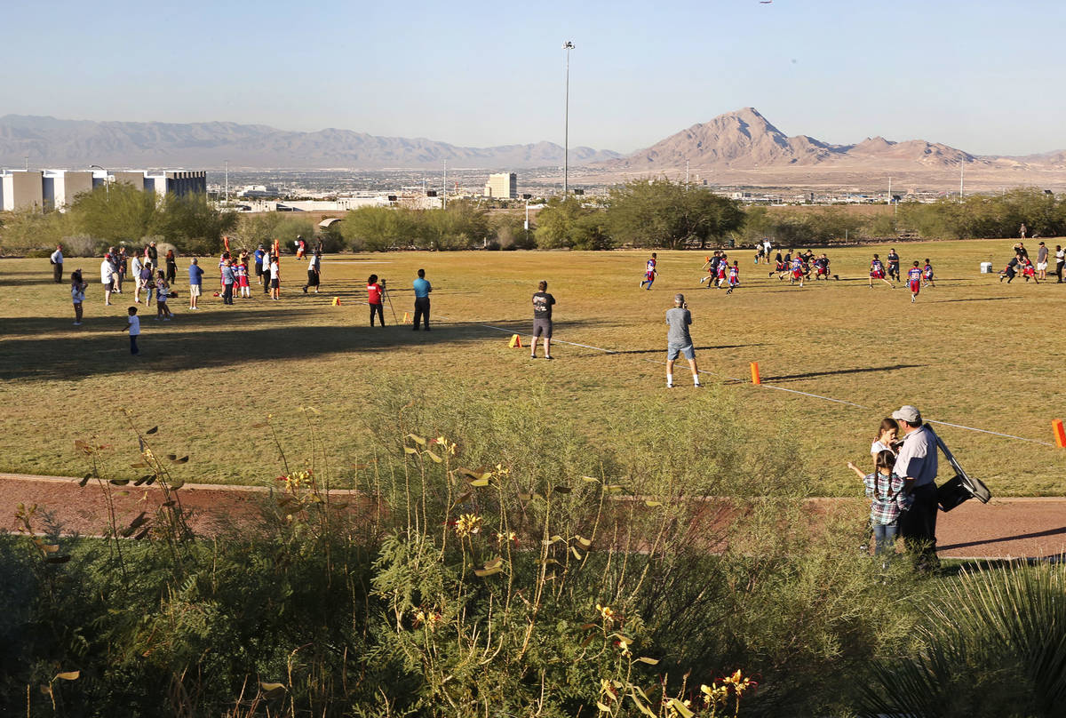 Children play flag football on the field behind Reunion Trails Park Thursday, Oct. 26, 2017, in ...