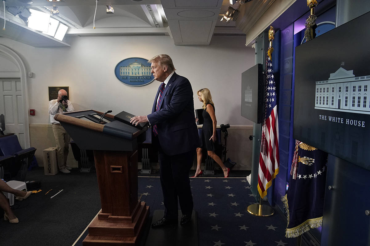 President Donald Trump arrives for a news conference at the White House, Tuesday, July 21, 2020 ...