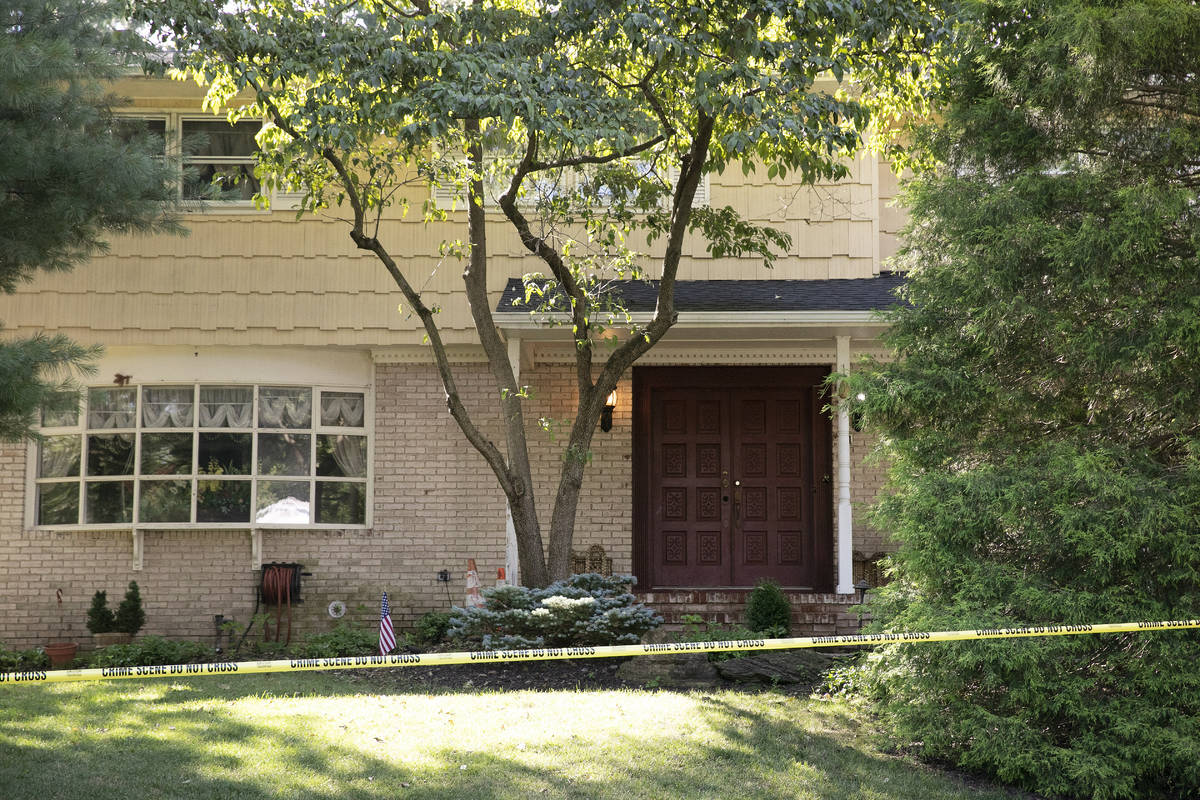 Crime scene tape surrounds the home of U.S. District Judge Esther Salas, Monday, July 20, 2020, ...