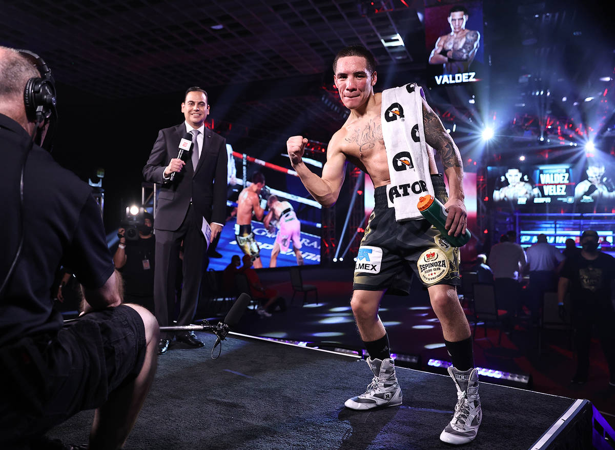 Oscar Valdez celebrates after his knockout of Jayson Velez in their junior lightweight fight on ...