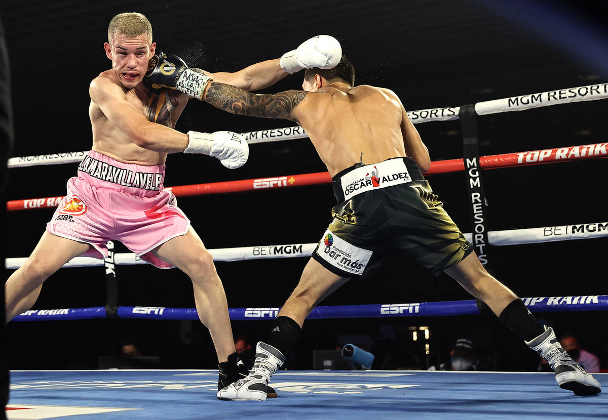 Oscar Valdez, right, and Jayson Velez trade punches during their junior lightweight fight on Tu ...