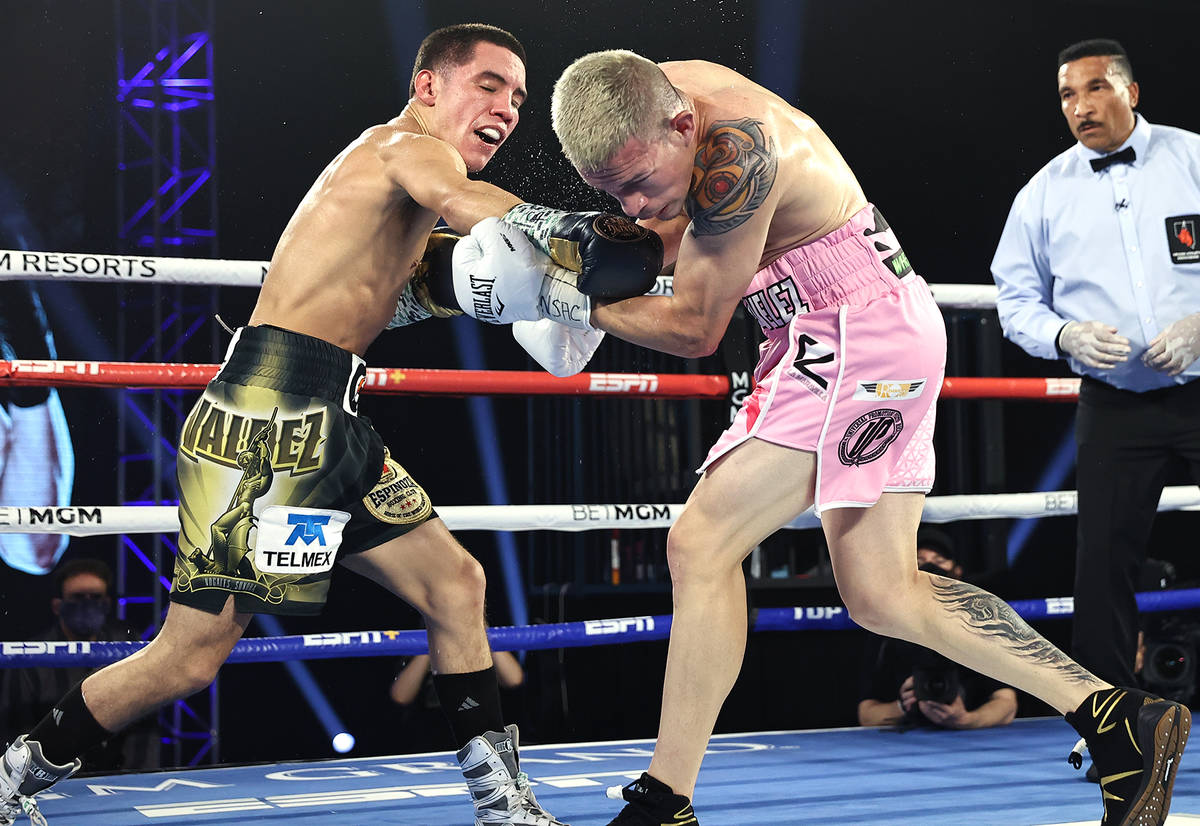 Oscar Valdez, left, connects with a punch against Jayson Velez during their junior lightweight ...
