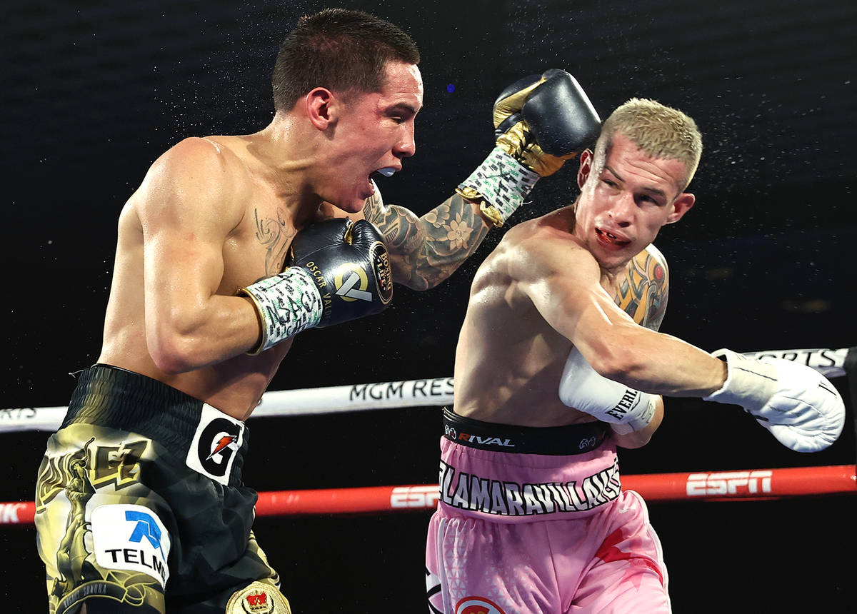 Oscar Valdez, left, and Jayson Velez trade punches during their junior lightweight fight on Tue ...