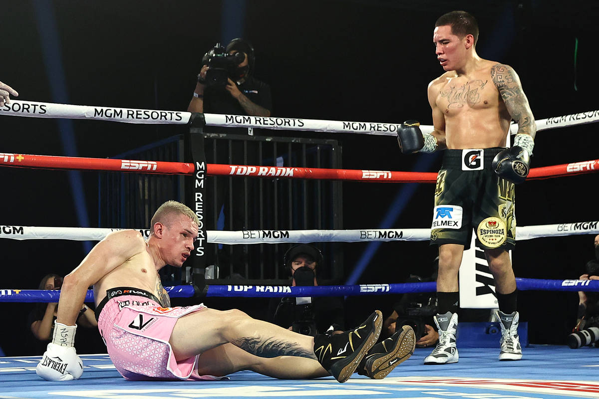 Oscar Valdez, right, knocks down Jayson Velez during their junior lightweight fight on Tuesday, ...