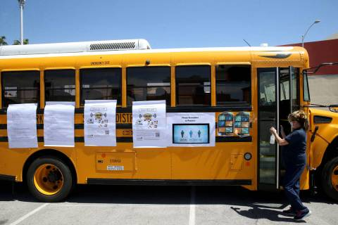 FILE--Clark County School District bus driver Marie Grootonk brings aWi-Fischool bus for st ...