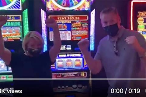 Two masked winners of nearly $270,000 celebrate at the D Las Vegas on Thursday, July 23, 2020. ...