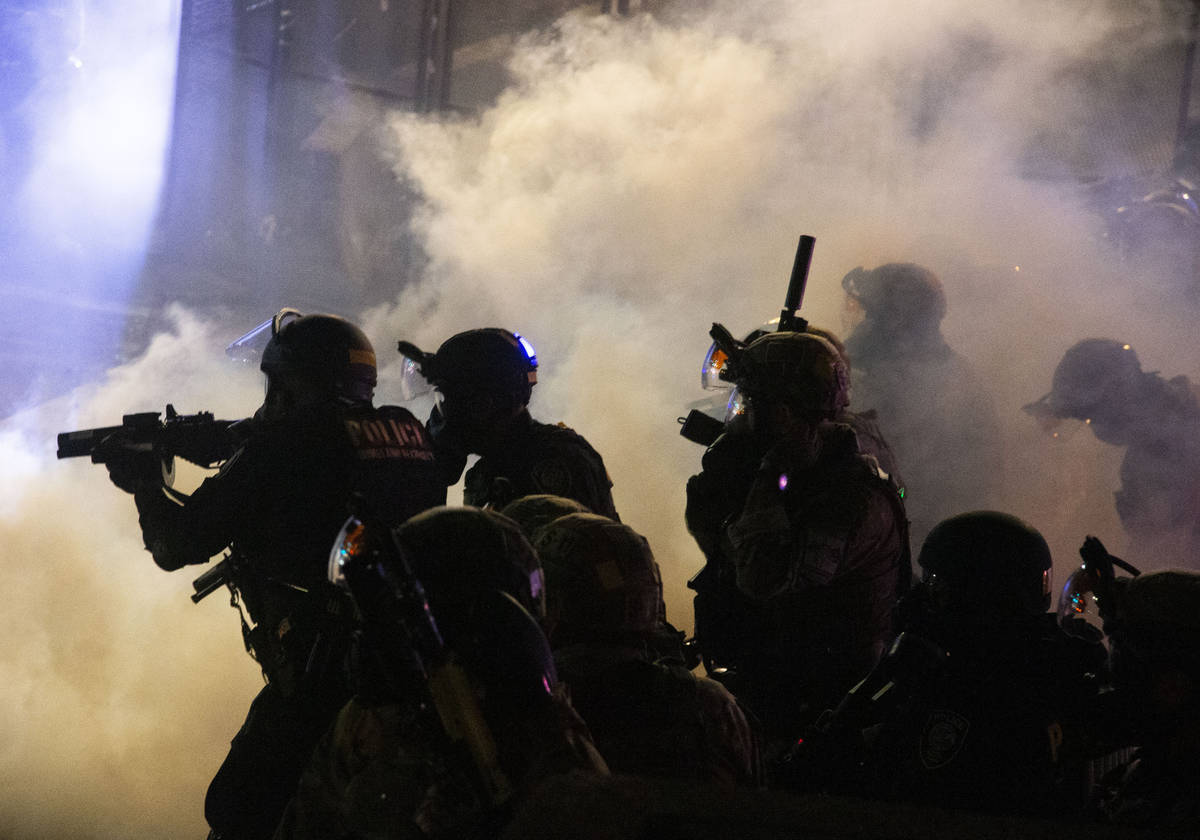 Federal officers use chemical irritants and projectiles to disperse Black Lives Matter proteste ...