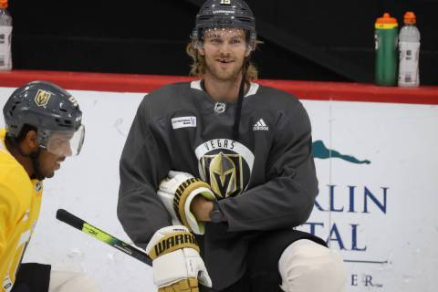 Vegas Golden Knights defenseman Jon Merrill (15) stretches during a team practice at City Natio ...