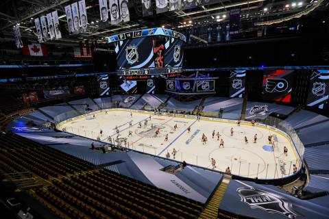 The Pittsburgh Penguins, left, and Philadelphia Flyers warm up before an exhibition NHL hockey ...