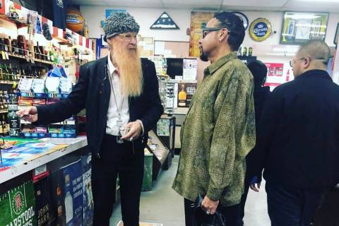 Billy Gibbons and Morris Day are shown at a store in Los Angeles during a break in recording se ...