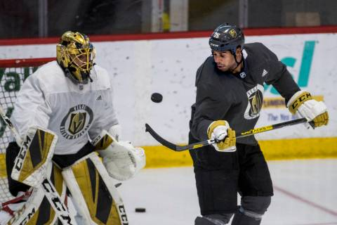 Vegas Golden Knights right wing Ryan Reaves (75, right) deflects a shot towards the net and goa ...