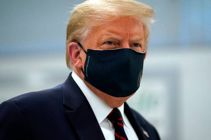 President Donald Trump wears a face mask as he participates in a tour of Bioprocess Innovation ...