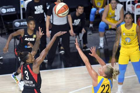 Las Vegas Aces guard Danielle Robinson (3) goes up to shoot in front of Chicago Sky guard Court ...