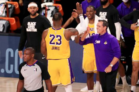 Los Angeles Lakers' LeBron James (23) celebrates with coach Frank Vogel after the Lakers defeat ...