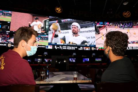 Dylan Speckman, left, and John Lewos, both of Jacksonville Beach, Fla., watch the Vegas Golden ...