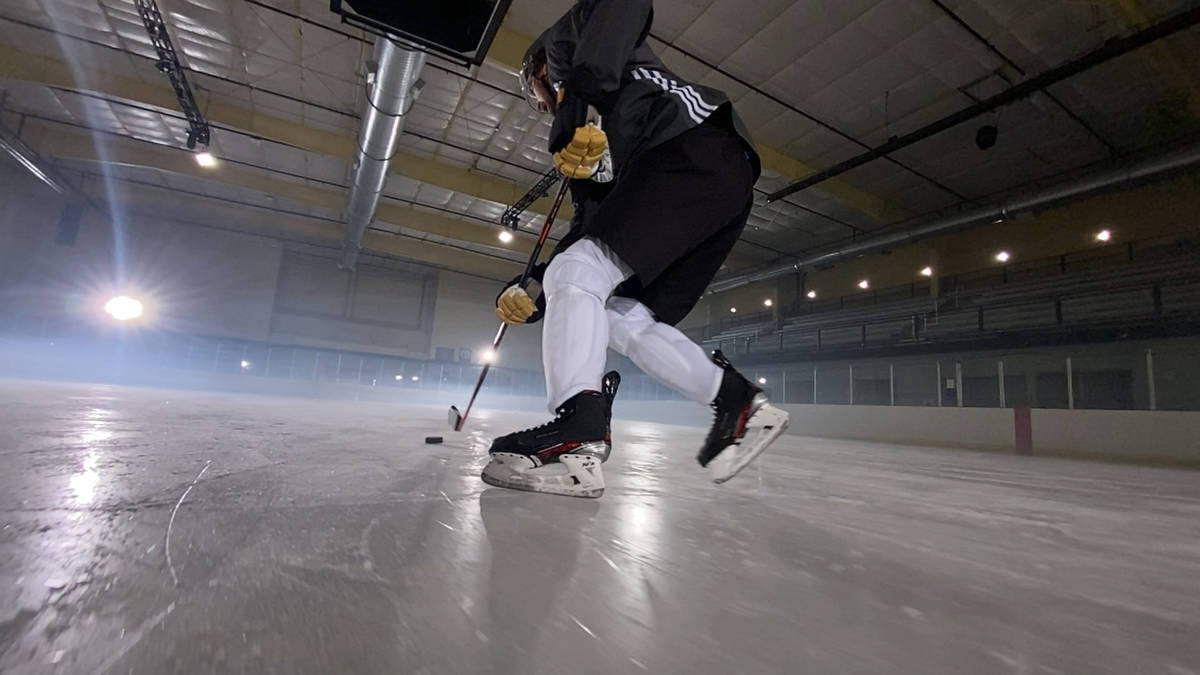 Golden Knights right wing Mark Stone stick handles a puck while filming an Apple commercial bef ...