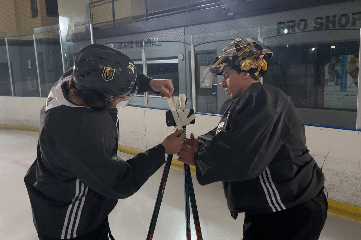 Golden Knights right wing Mark Stone and goaltender Marc-Andre Fleury tape an iPhone 11 Pro to ...