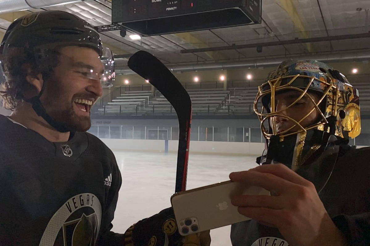 Fleury and Stone reviewing their Shot on iPhone footage during a break in the action in Las Veg ...