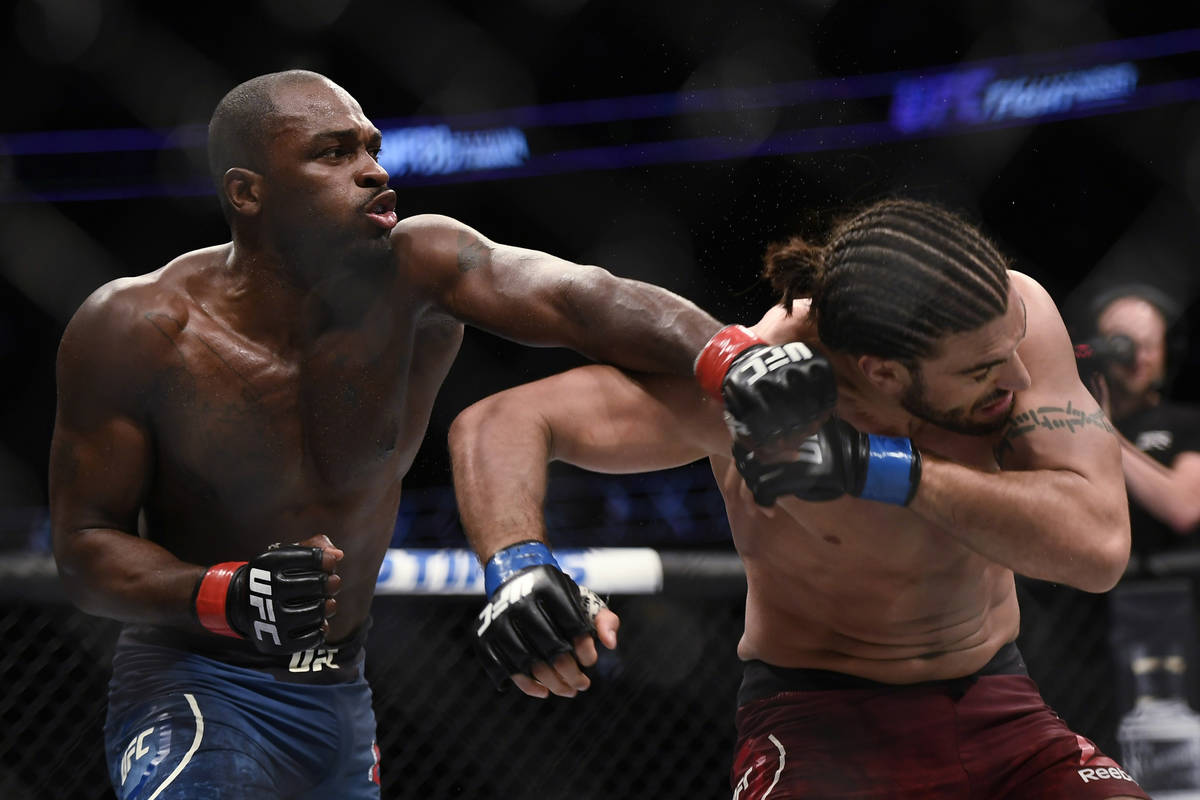 Derek Brunson, left, punches Elias Theodorou during a middleweight mixed martial arts bout duri ...