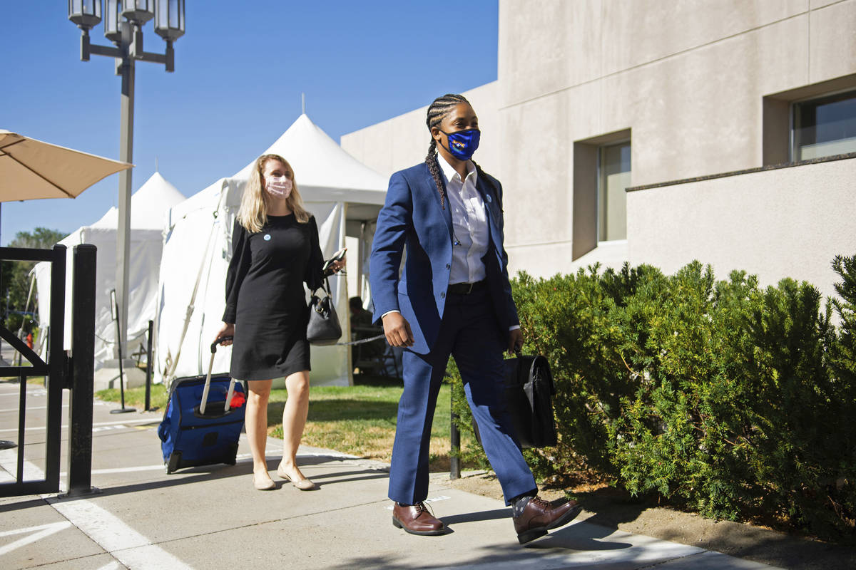 State Senators Dallas Harris, right, and Melanie Scheible arrive at the Legislature on Friday, ...