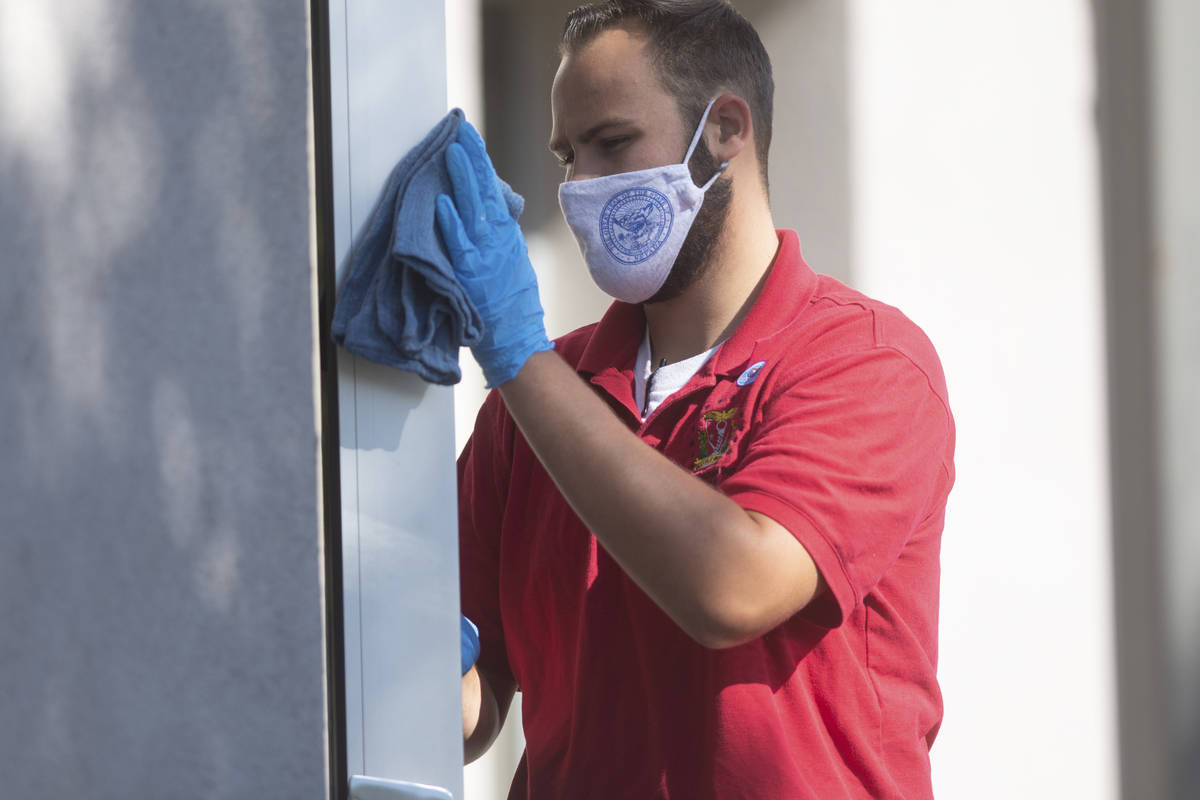 A member of the legislative janitorial crew cleans on Friday, July 31, 2020 during the first da ...