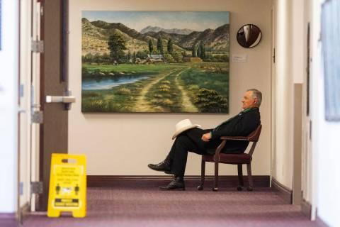 Senate Minority Leader James Settelmeyer makes a phone call outside his office on Friday, July ...