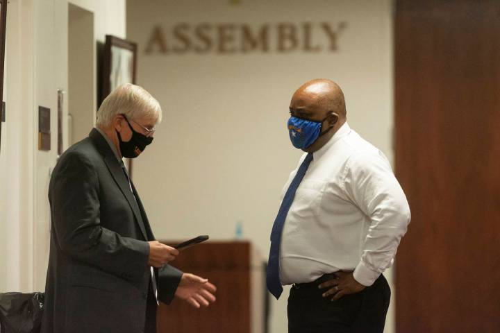 In this July 16, 2020, file photo, Assembly Speaker Jason Frierson, right, speaks with Assembly ...