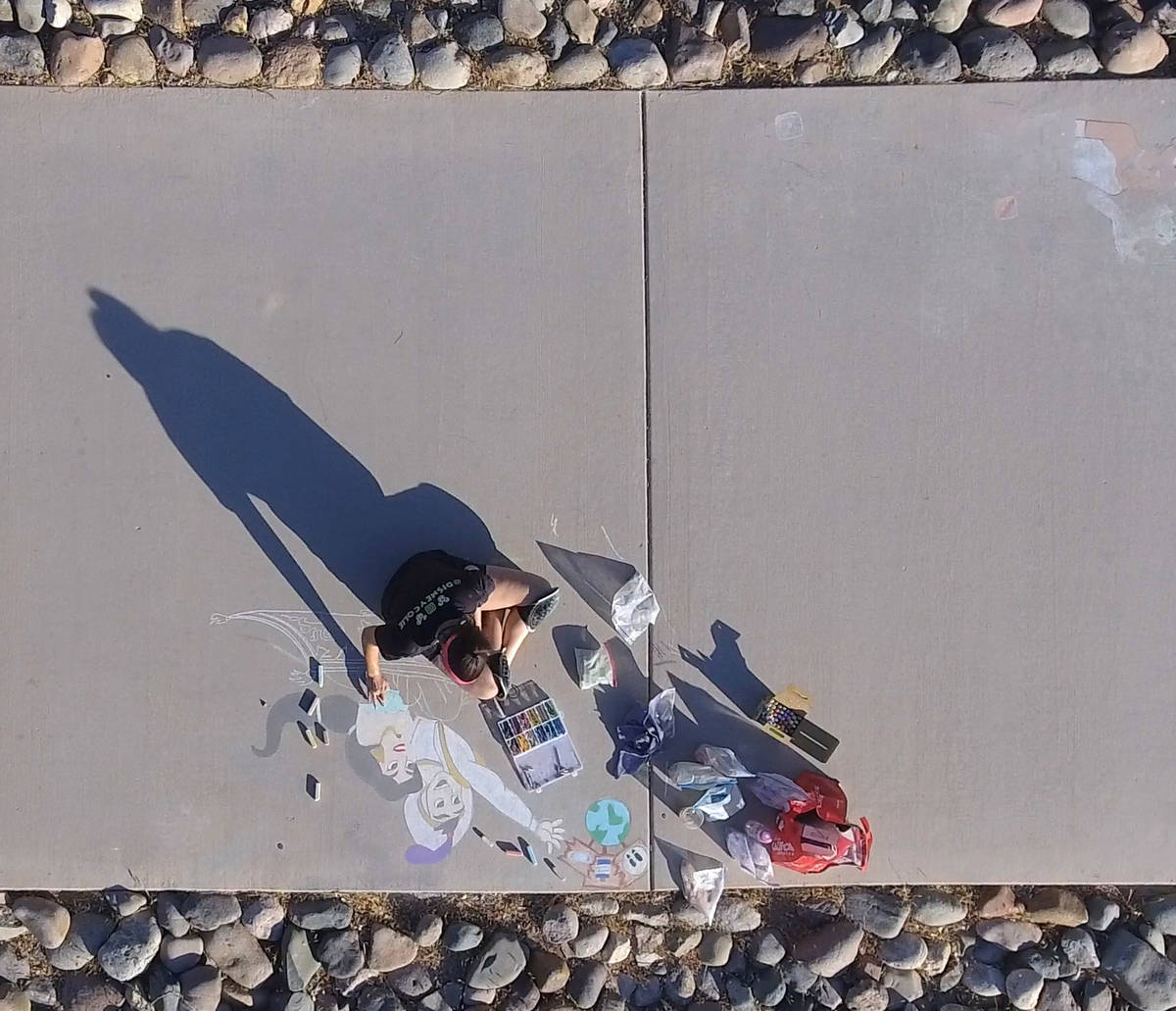 Nicole Cox, of Las Vegas, works on a public chalk drawing on Friday, July 3, 2020, at Nevada Tr ...