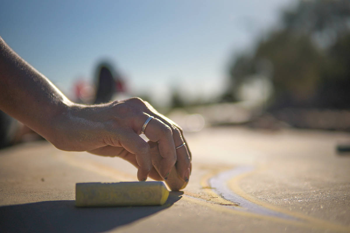 Nicole Cox works on a public chalk drawing on Friday, July 3, 2020, at Nevada Trails Park in La ...