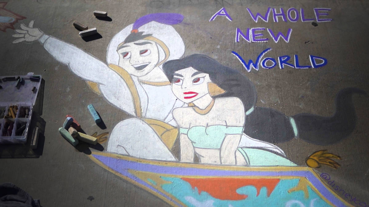 "A public chalk drawing by Nicole Cox, of Las Vegas, called ""A Whole New World"" at Nevada Trails ..."