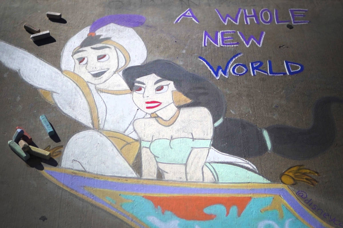 "A public chalk drawing by Nicole Cox, of Las Vegas, called ""A Whole New World"" features Dis ..."