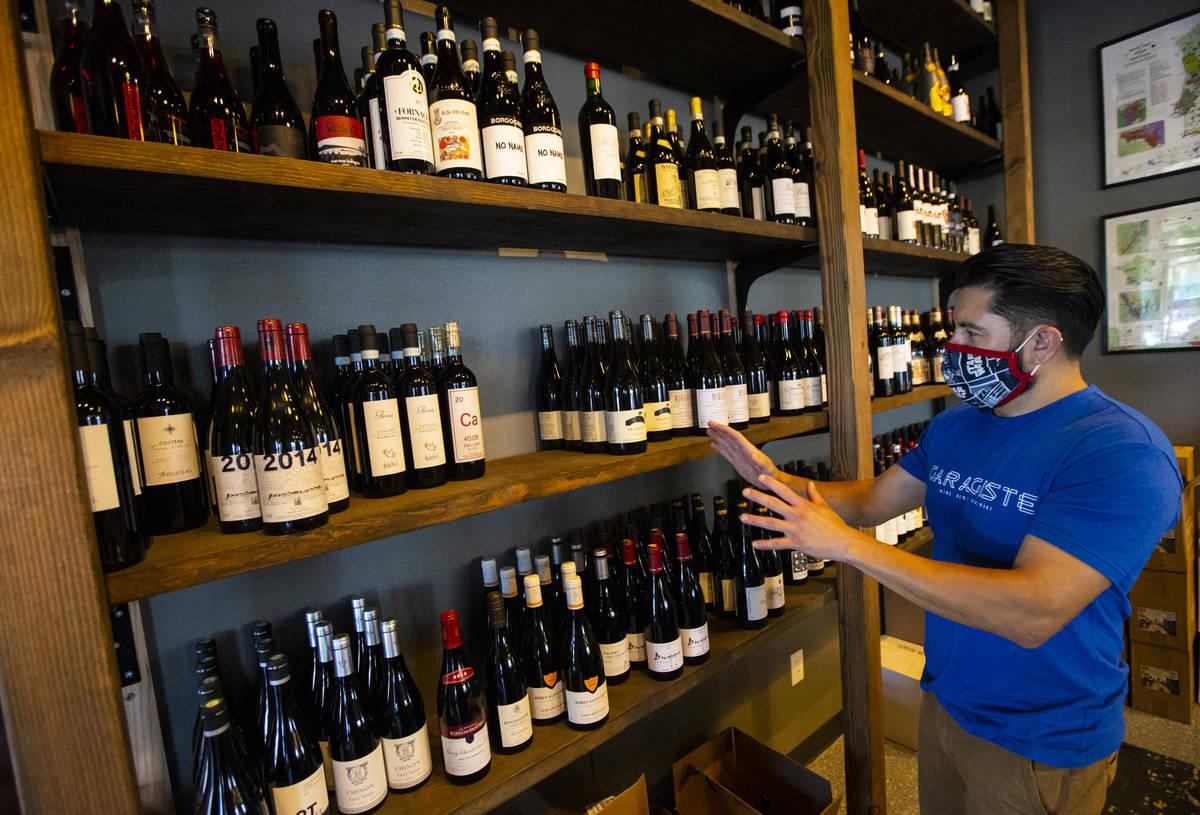 Mario Enriquez, co-founder of Garagiste Wine Room & Merchant, talks about wines at his business ...