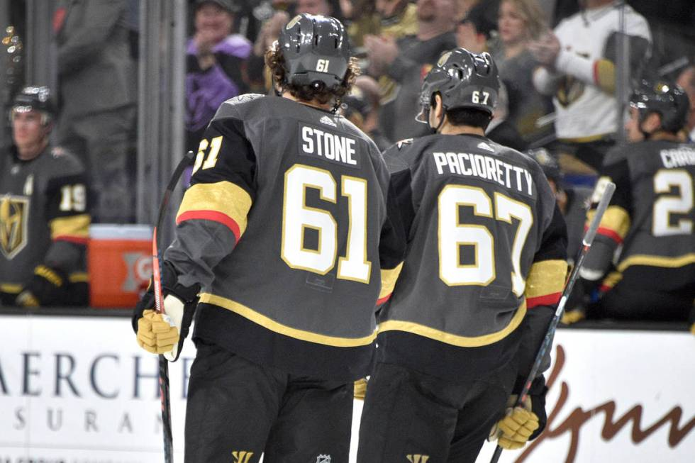 Vegas Golden Knights right wing Mark Stone (61) and left wing Max Pacioretty skate together aga ...