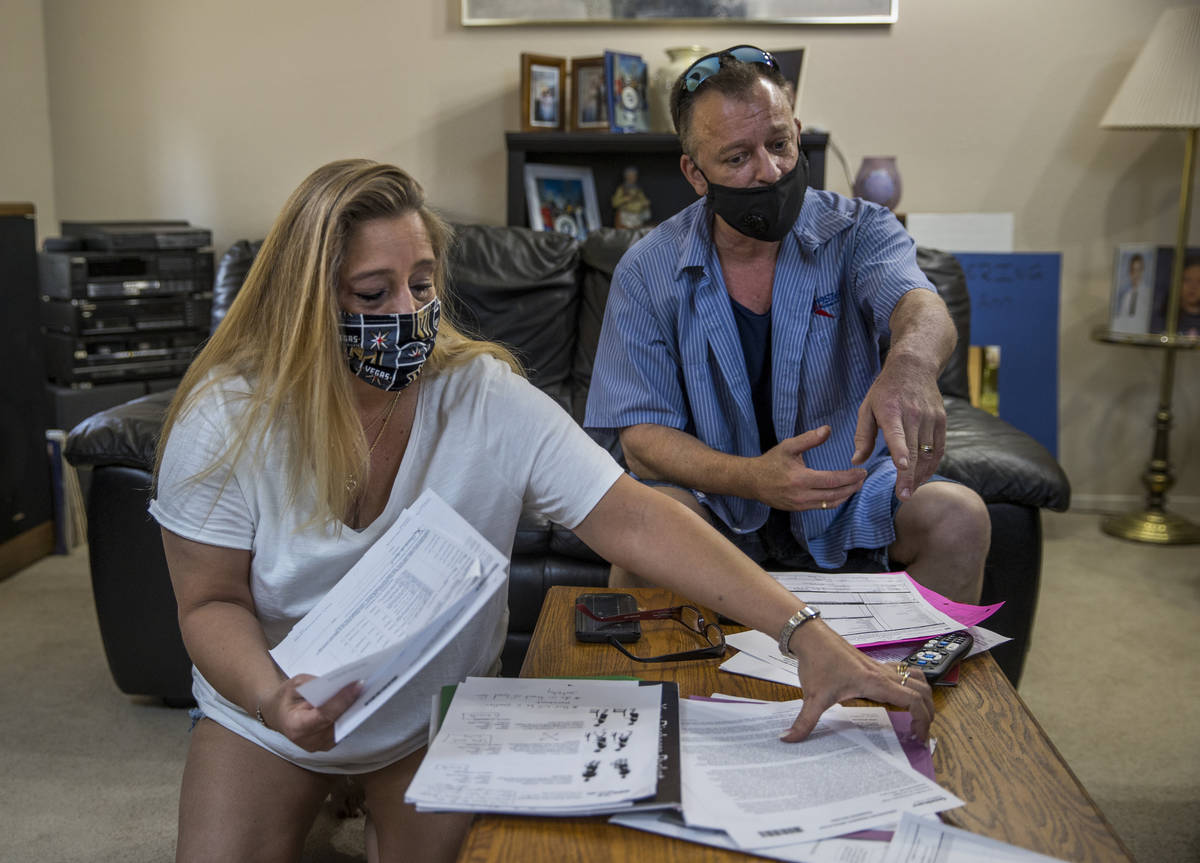 Tracy and David LaMonica look through some of her mother's paperwork, 80-year-old Phyllis Wyant ...