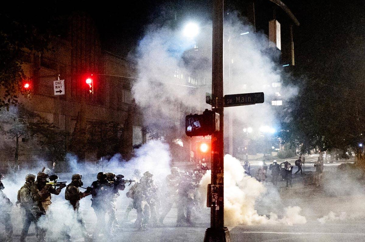 Federal agents use crowd control munitions to disperse Black Lives Matter protesters near the M ...