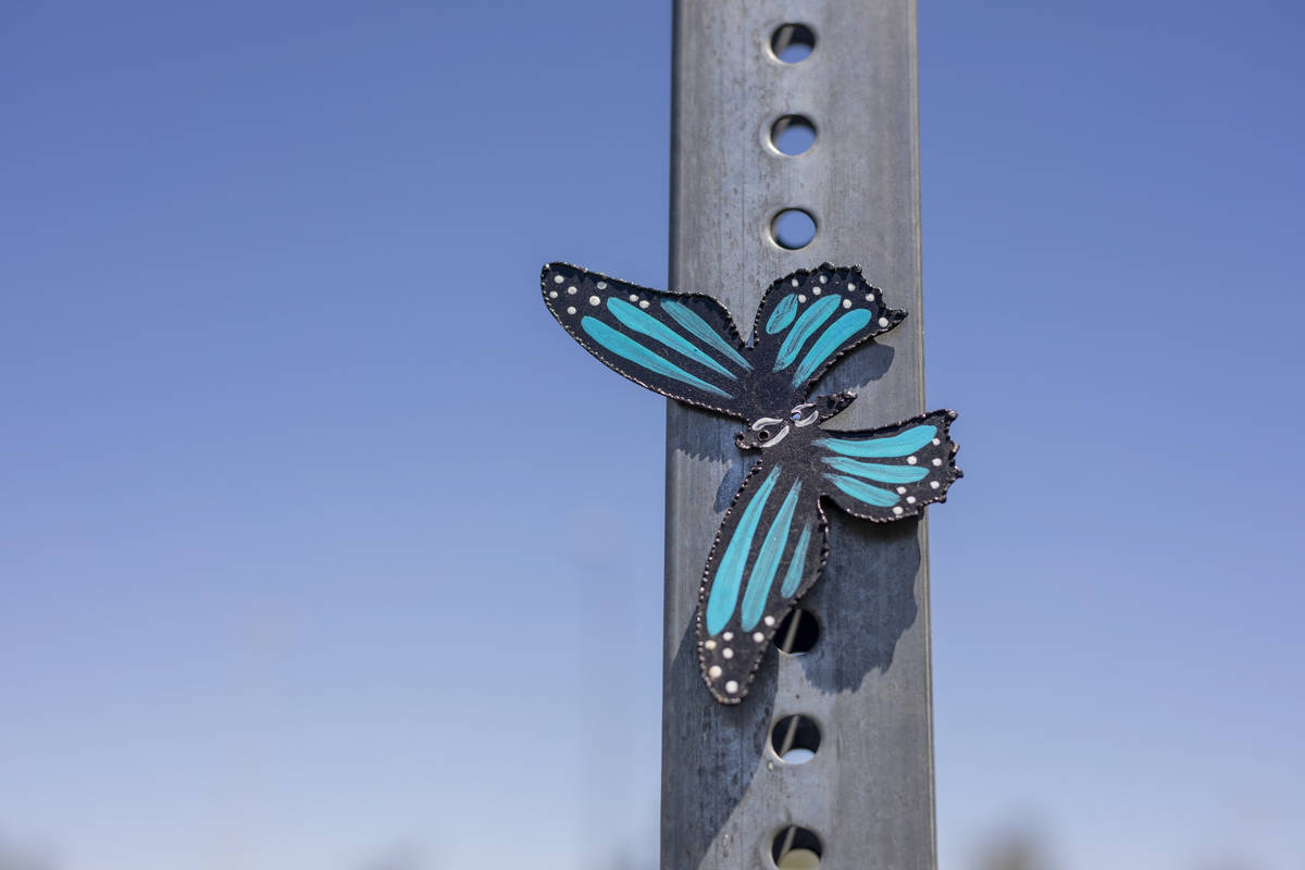 A metal butterfly created by Isaias Urrabazo, a local artist, is pictured in the parking of Mou ...