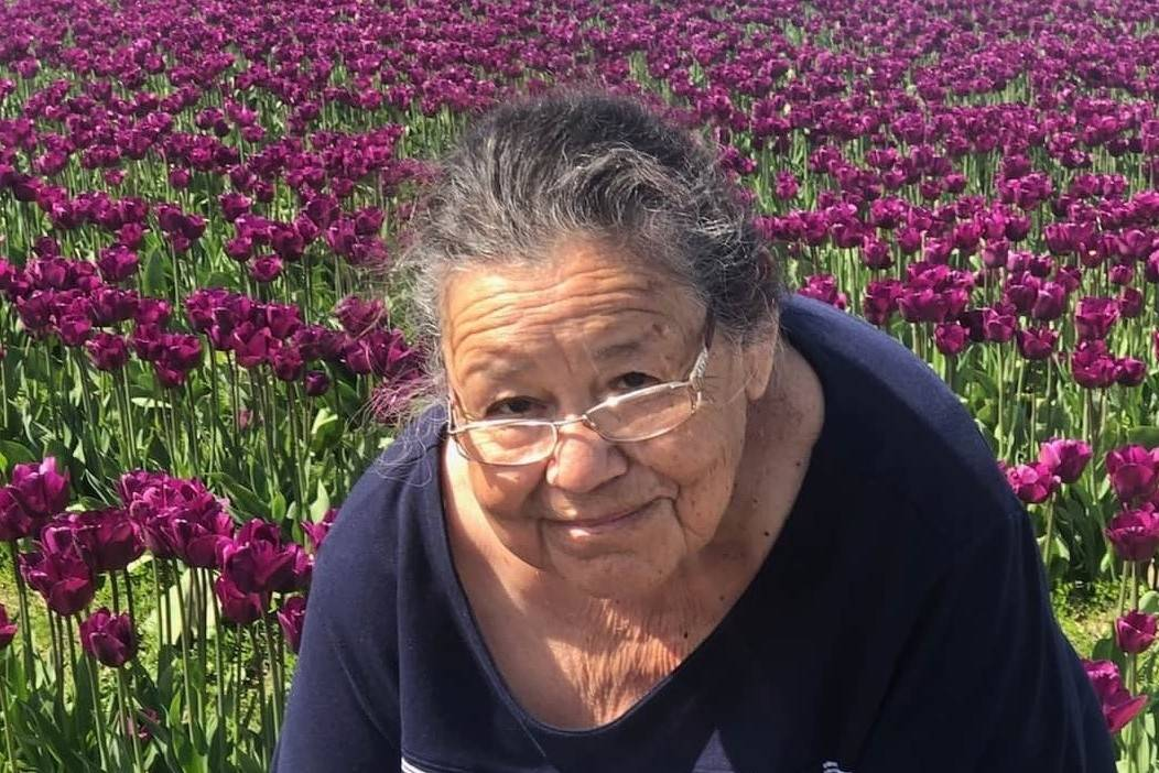 An undated photo of Maria Urrabazo in a field of flowers. Urrabazo died on June 3, 2020, from C ...