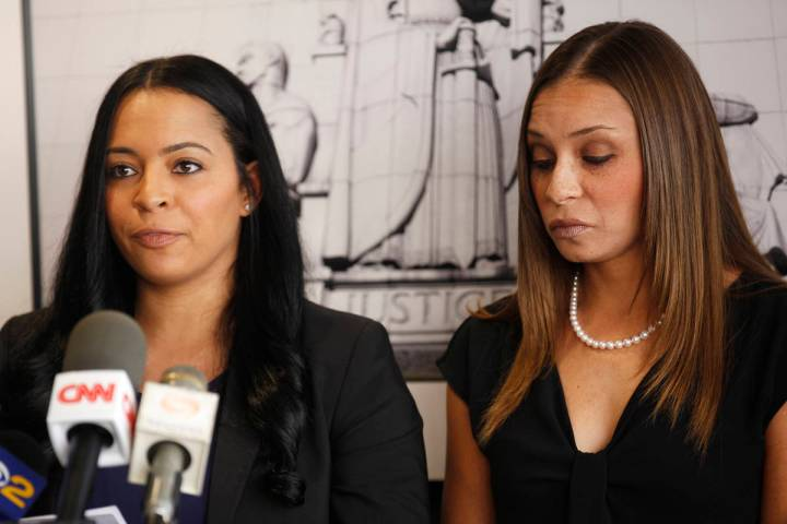 Tasha Schwikert, left, addresses the media next to her sister Jordan Schwikert at the offices o ...